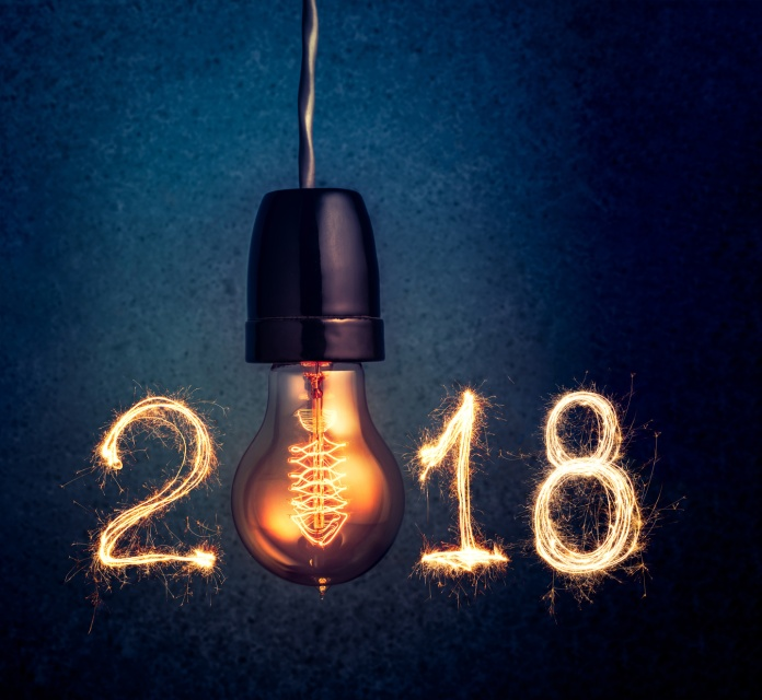 2018 written with Sparkle firework and light bulb , abstract 2018 Happy New Year background concept.